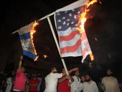 People burn U.S. and Israeli flags during a protest about a film ridiculing Islam's prophet Mohammed in Sidon, Lebanon, on Thursday.