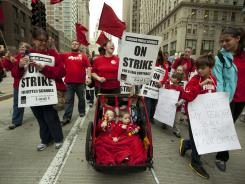 Public school teachers and their supporters march in Chicago on Thursday.