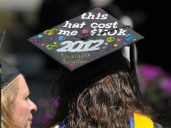 A student describes her loan debt on her graduation cap at Centenary College Commencement Ceremony.