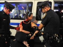 An Occupy Wall Street protester is arrested in New York on Saturday.