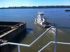 A tugboat on the Ohio River delivers empty barges to be filled with coal.