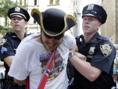 A demonstrator is arrested at an Occupy Wall Street rally in New York in July.