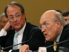 of the National Commission on Fiscal Responsibility and Reform, former Sen. Alan Simpson, and Erskine Bowles participate in a Joint Deficit Reduction Committee hearing on Capitol Hill.