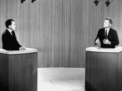 John F. Kennedy, D-Mass., right, speaks and Vice President Richard M. Nixon listens during the fourth presidential debate from a New York studio.