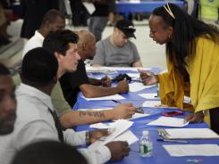 Job seekers fill out applications at a construction job fair last month in New York.