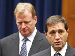 NFL football lead counsel Jeff Pash, right, and NFL Commissioner Roger Goodell.