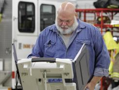 Denis Sheets votes at a fire station near Wakeman, Ohio, on Nov. 8, 2011.