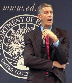 U.S. Education Secretary Arne Duncan participates in a round-table discussion. &quot;Our K-12 system and our teacher preparation programs have to get dramatically better,&quot; he says.