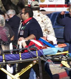 Rep. Gabrielle Giffords as she is carried from the scene of the shooting on Saturday. An intern's quick thinking may have saved Giffords' life.