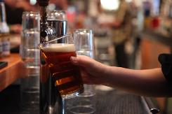 Downing more than three alcoholic drinks per day for men and more than two daily for women is risky, a study finds.