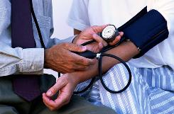 A doctor checks a patient's blood pressure. About 30% of U.S. adults have hypertension.