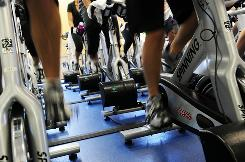 "People work out at a gym in New York. In this study, ""regular"" exercise was considered 20 minutes of heart-rate raising activity at least five times a week."
