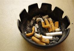 Cigarette butts in an ashtray at a diner. Studies suggests that public smoking bans could prevent more than 150,000 heart attacks a year, according to Cardiology.