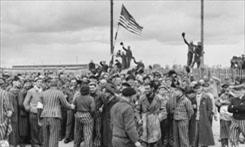 At concentration camp: Inmates greet U.S. troops.