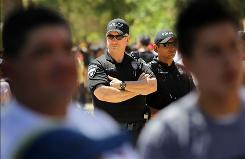 In Phoenix: Police monitor a demonstration against the new immigration law Sunday.