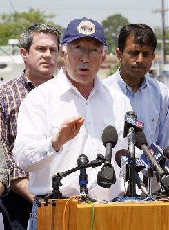 Interior Secretary Ken Salazar, center, speaks at a news conference in Galliano, La., on Monday, Behind him are Sen. David Vitter, R-La., and Louisiana Gov. Bobby Jindal, right.