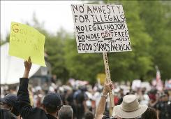 Not in my backyard: Anti-immigration demonstrators rally in Dallas last month.