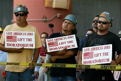 Roughnecks' stand: Rig workers rally Thursday in Houma, La., against the drilling moratorium.