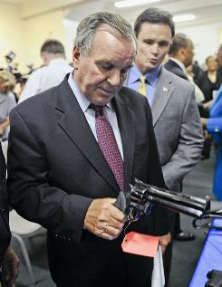 Chicago Mayor Richard Daley at a gun turn-in program in August.