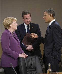 In Canada: President Obama speaks with German Chancellor Angela Merkel and British Prime Minister David Cameron.