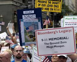 People in New York protest on June 6 the proposed construction of a Muslim center  near the World Trade Center site.