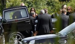 6 months after estate tax expired: Family and friends move George Steinbrenner's coffin into his funeral service on Saturday in Trinity, Fla.