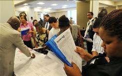 At job fair: Americans out of work at least six months would get their federal aid extended.