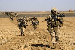 In Afghanistan: U.S. troops swarm the south in an intensified hunt for the Taliban.