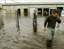 Water from heavy rains in 2007 flooded a shop that had recently opened after Hurricane Katrina.