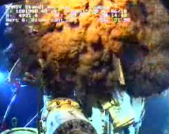 This file image from video in early June shows oil leaking out of the well head around the capping device in the Gulf  of Mexico.