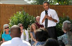 Backyard summit: President Obama answers questions Wednesday at a home in Falls Church, in Northern Virginia.