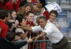 Trying to reconnect: President Obama leads a rally last week at the University of Wisconsin-Madison.