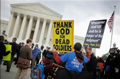 Outside Supreme Court: The Rev. Fred Phelps' group demonstrates Wednesday.