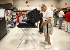 Early vote: Ed Stolarczyk casts his ballot Oct. 16 in Las Vegas.