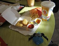 Happy?: San Francisco legislation would prohibit giving away toys with unhealthy meals.