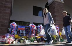 A makeshift memorial at the Safeway in Tucson, scene of the mass shooting that killed six and injured Rep. Gabrielle Giffords. 