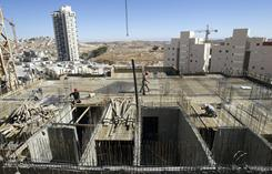 Near Bethlehem: Palestinian laborers work on a new housing project at an Israeli settlement.