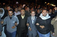 Cairo: Muslim Brotherhood leaders Essam el-Erian, center right, and Saad el-Katatni, center left, during a protest in the Egyptian capital on Sunday.