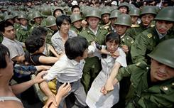 Tiananmen Massacre: A young woman is caught between civilians and Chinese soldiers.