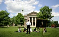 College: A group of students meet on the lawn outside Webster Hall on the campus of Dartmouth College. 