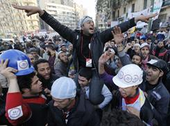 Still celebrating: Thousands of Egyptians are still in Cairo's Tahrir Square on Sunday.