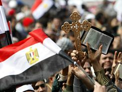 Side by side: Egyptian Coptic Christians and Muslims raise a cross and the Quran in Tahrir Square during anti-government protests. The demonstrations started Jan. 25 and took down President Hosni Mubarak.