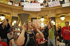 In Madison, Wis.: State workers want to keep their collective bargaining rights.