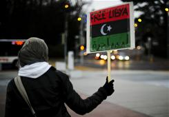 An anti-Gadhafi demonstrator joins a rally in front of the United Nations in Geneva on Wednesday.