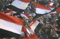 In Cairo: Protesters celebrate on Friday, a week after bringing down the Mubarak government.