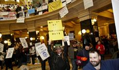 In the Capitol: Police officers join the pro-union demonstrators in Madison on Wednesday.