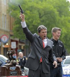 Texas Governor Rick Perry has said that he favors a proposal to allow guns on campuses statewide.