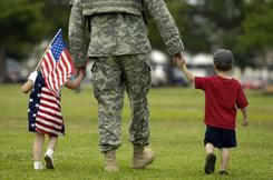 Homecoming: A soldier reunites with his kids in Georgia's Fort Stewart.