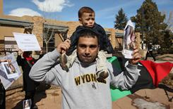 In Laramie, Wyo.: Ahmed Elghriny, a Libyan student, rallies for his homeland on Wednesday.