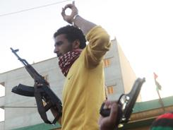 Libyan rebels parade with their guns in the streets of the eastern Libyan coastal town of Tobruk, near the border with Egypt.